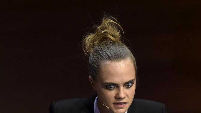 British model and actress Delevingne speaks at the Women in the World summit in London, Britain