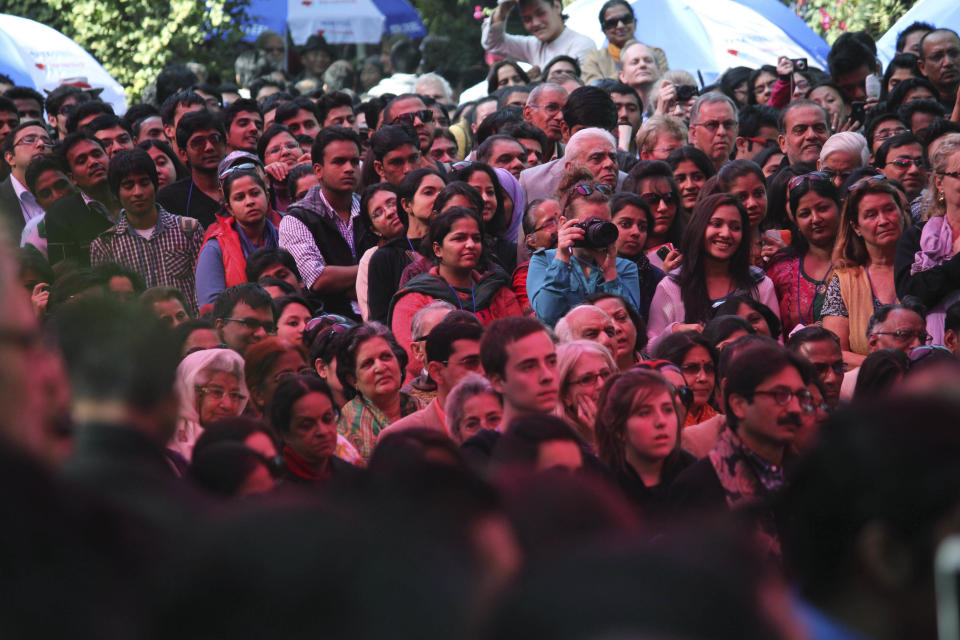 People listen to the Dalai Lama, on the opening day of India's Jaipur Literature Festival in Jaipur, India, Thursday, Jan. 24, 2013. This year's festival will also feature author Zoe Heller and Booker Prize winner Howard Jacobson. (AP Photo/Deepak Sharma)