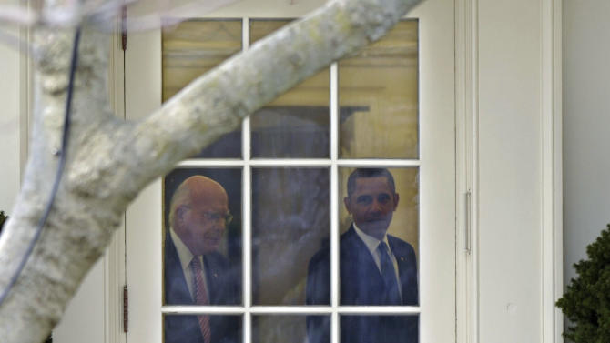 FILE - In this Feb. 4, 2013 file photo Senate Judiciary Committee Chairman Sen. Patrick Leahy, D-Vt., left, and President Barack Obama talk in the Way House Oval Office before Obama's departure for Minneapolis to speak about his gun-control proposals. Leahy, 72, has served for nearly four decades in the upper chamber, and earned his perch as one of the Senate's most powerful, and visible, members. Now he is front and center in two of the most contentious fights facing a bitterly divided Senate: guns and immigration. (AP Photo/Susan Walsh, File)