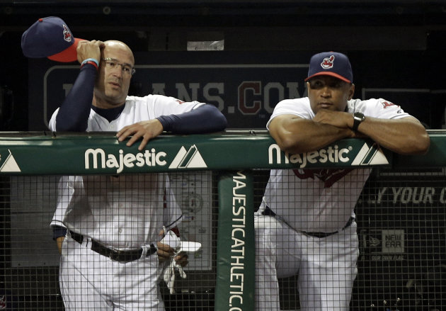 FILE - This Aug. 27, 2012 file photo shows Cleveland Indians manager Manny Acta, left, and bench coach Sandy Alomar, Jr., watching from the dugout in the eighth inning of a 3-0 loss to the Oakland Athletics, in Cleveland. The Indians have fired Acta after the team collapsed from contention. The Indians announced Acta will not return in 2013 on Thursday, Sept. 27, 2012, an off day before opening their final homestand. (AP Photo/Mark Duncan, File)