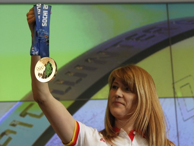 Russian former speed skater and Olympic champion Zhurova presents a gold medal for the 2014 Winter Olympic Games in Sochi during a ceremony in St. Petersburg