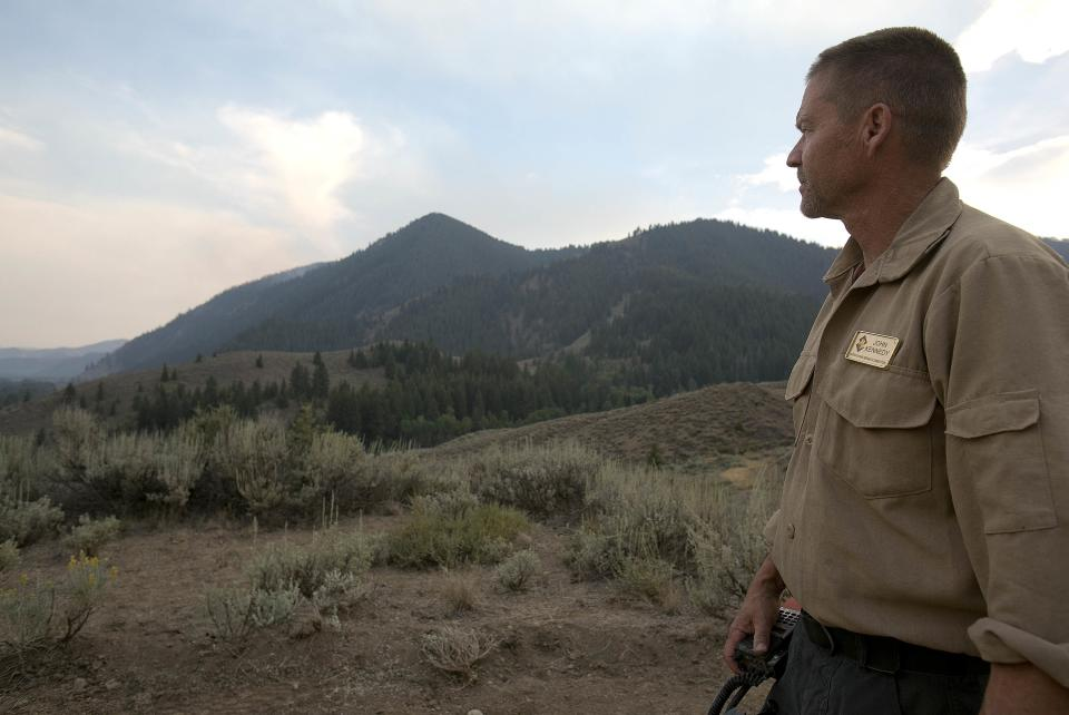 "John Kennedy, a Operations Branch Manager for the Beaver Creek Fire looks at late day firefighting efforts on the Beaver Creek Fire near Ketchum, Idaho. Kennedy said firefighting efforts went very well during the day. ""We made hay today"", Kennedy said. Monday Aug. 19, 2013. (AP Photo/Idaho Statesman, Kyle Green)"