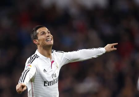 Real Madrid's Cristiano Ronaldo celebrates his second goal against Celta Vigo during their Spanish First Division soccer match in Madrid