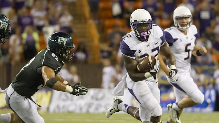 Washington running back Lavon Coleman (22) sprints away from Hawaii linebacker Tevita Lataimua (52) and runs for a first down that seals the game late in the fourth quarter of an NCAA college football game, Saturday, Aug. 30, 2014, in Honolulu. Washington quarterback Jeff Lindquist (5) looks on during the play. Washington defeats Hawaii 17-16. (AP Photo/Eugene Tanner)