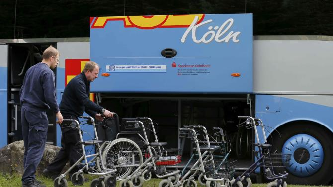 Worker's of Germany's welfare organisation ASB line up walking frames as residents of a nearby nursing home are evacuated in a special bus in Cologne