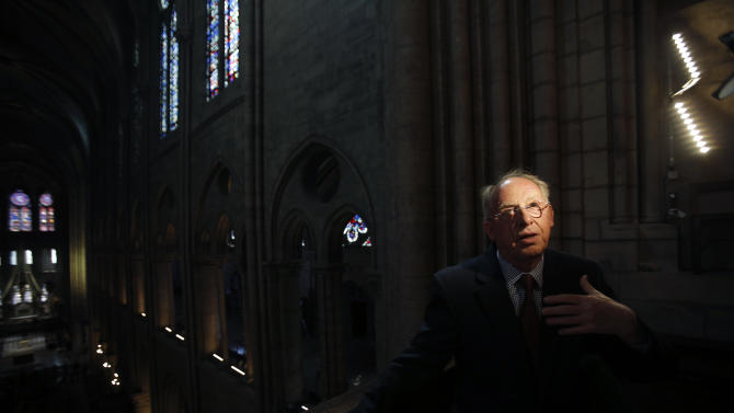 In this Thursday, May 2, 2013 photo, Notre Dame cathedral organist Philippe Lefebvre describes his work during an interview with The Associated Press in Paris. Despite the advances in organ technology, Lefebvre feels the weight of history in his job.  (AP Photo/Christophe Ena)