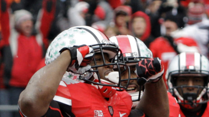Ohio State running back Carlos Hyde (34) celebrates after a 3-yard touchdown run against Michigan in the first quarter of an NCAA college football game Saturday, Nov. 24, 2012, in Columbus, Ohio. (AP Photo/Jay LaPrete)