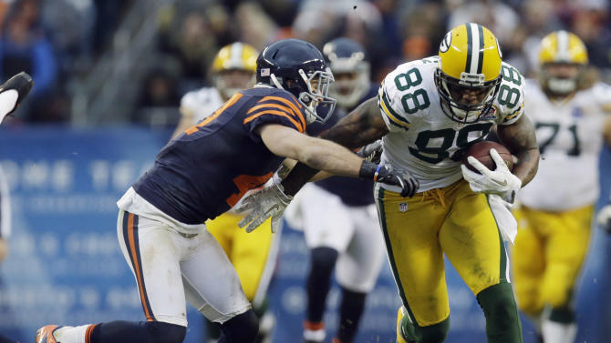 Green Bay Packers tight end Jermichael Finley (88) is pursued by Chicago Bears safety Chris Conte in the second half of an NFL football game in Chicago, Sunday, Dec. 16, 2012. The Packers won 21-13 to clinch the NFC North division title.(AP Photo/Nam Y. Huh)