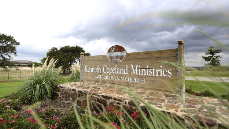 This Aug. 27, 2013, photo shows a sign at the entrance of the Kenneth Copeland Ministries Eagle Mountain Church, in Newark, Texas. The Texas megachurch is linked to at least 21 cases of measles and has been trying to contain the outbreak by hosting vaccination clinics, officials said. (AP Photo/LM Otero)