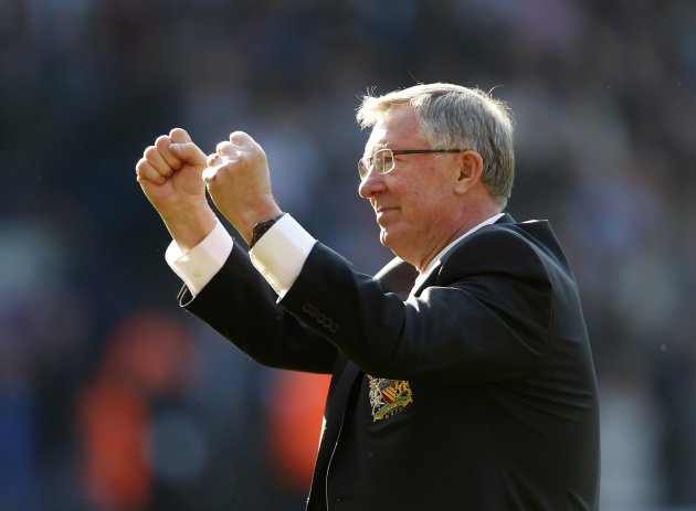 Manchester United manager Alex Ferguson salutes the fans after their English Premier League soccer match against West Bromwich Albion at The Hawthorns in West Bromwich