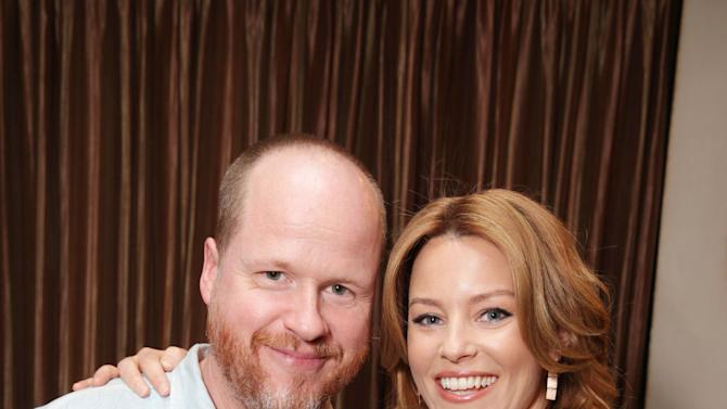 """Joss Whedon, screenplay writer of """"Much Ado About Nothing"""" and Elizabeth Banks, cast member in the upcoming film """"The Hunger Games: Catching Fire""""  at Lionsgate Presentation at 2013 CinemaCon, on Thursday, April, 18th, 2013 in Las Vegas. (Photo by Eric Charbonneau/Invision for Lionsgate/AP Images)"""