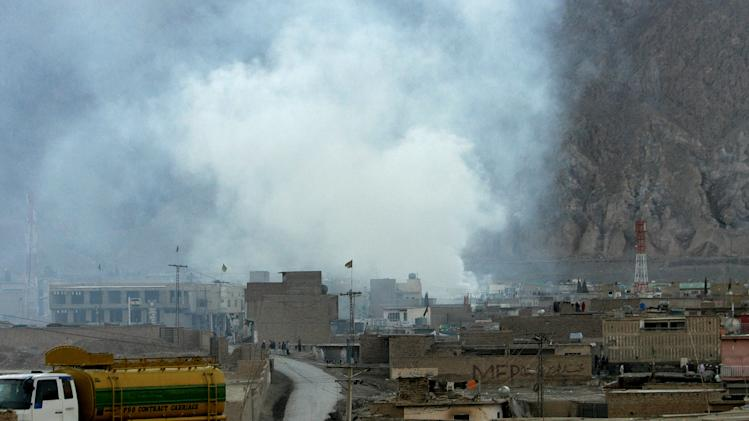 Smoke rises from the site of a bomb blast in a market in Quetta, Pakistan on Saturday, Feb. 16, 2013. Senior police officer Wazir Khan Nasir said the bomb went off in a Shiite Muslim-dominated residential suburb of the city of Quetta. Residents rushed the victims to three different hospitals.(AP Photo/Arshad Butt)