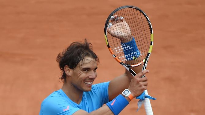 Spain's Rafael Nadal celebrates after defeating France's Quentin Halys during the men's first round at the Roland Garros 2015 French Tennis Open in Paris on May 26, 2015