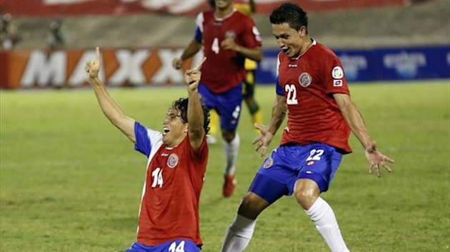 Costa Rica's Randall Brenes (kneeling) celebrates his goal against Jamaica (Reuters)