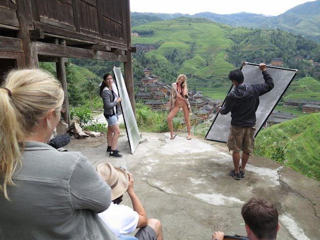 This Sept. 10, 2012 image released by Sports Illustrated shows a model being photographed on location in Guilin, China, for the 2013 Sports Illustrated Swimsuit issue. Sports Illustrated took its mode