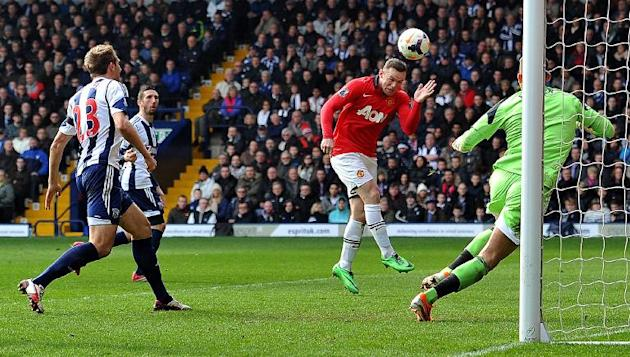 Manchester United's striker Wayne Rooney (2nd R) heads the ball to score past West Bromwich Albion's goalkeeper Ben Foster (R) during an English Premier League football match at The Hawthorns