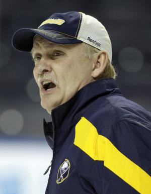 FILE - In this Jan. 11, 2012 file photo, Buffalo Sabres coach Lindy Ruff talks with players during NHL hockey practice in Buffalo, N.Y. Ruff has been hired as the new coach of the Dallas Stars. The team announced the hiring on Friday, June 21, 2013. (AP Photo/David Duprey, File)