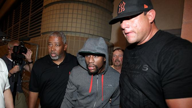 Floyd Mayweather Jr., exits the Clark County Detention Center after serving two months of a three-month sentence in a misdemeanor domestic battery case, Friday, Aug. 3, 2012, in Las Vegas. (AP Photo/Isaac Brekken)