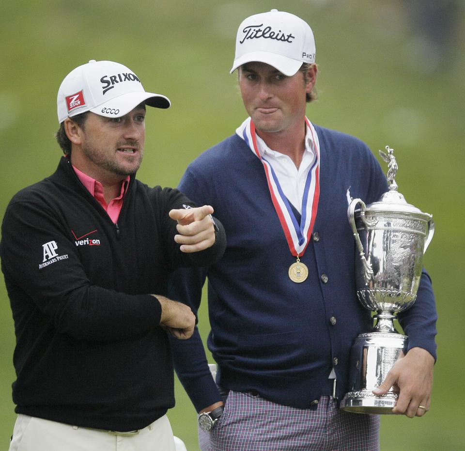 Webb Simpson talks to runner up Graeme McDowell, of Northern Ireland, after the U.S. Open Championship golf tournament Sunday, June 17, 2012, at The Olympic Club in San Francisco. (AP Photo/Eric Risberg)
