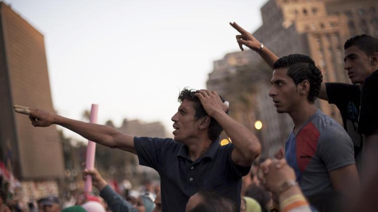 Men chant slogans against Egyptian President Mohammed Morsi during a demonstration supporting in Tahrir Square in Cairo, Egypt, Wednesday, June 26, 2013.(AP Photo/Manu Brabo)