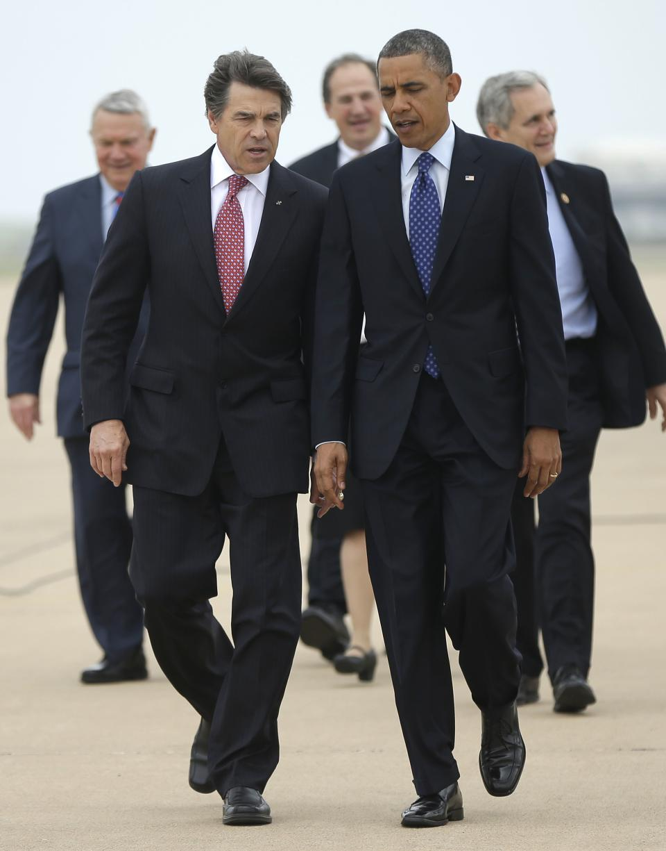 President Barack Obama, right, talks with Texas Gov. Rick Perry, left, as the walk on the tarmac during his arrival on Air Force One at Austin-Bergstrom International Airport, Thursday, May 9, 2013 in Austin, Texas. (AP Photo/Pablo Martinez Monsivais)