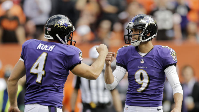 Baltimore Ravens kicker Justin Tucker (9) is congratulated by teammate Sam Koch (4) after booting a 32-yard field goal as time expired to defeat the Cleveland Browns 23-21 in an NFL football game Sunday, Sept. 21, 2014, in Cleveland. (AP Photo/Tony Dejak)