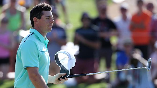 Northern Ireland's Rory McIlroy removes his hat after finishing his third round of the Australian Open Golf championship in Sydney, Saturday, Nov. 29, 2014. McIlroy, who had a triple bogey on the ninth hole and a double-bogey on 10, was six strokes from the lead, tied for 14th. (AP Photo/Rick Rycroft)