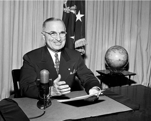 FILE - In this Sept. 1, 1945 file photo, then-U.S. President Harry Truman sits before a microphone at the White House in Washington, where he broadcast a message on the formal surrender of Japan. Clif