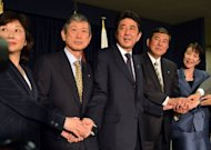 <p>Japan's incoming Prime Minister and leader of Liberal Democratic Party (LDP) Shinzo Abe (C) shakes hands with his party's new executives: Seiko Noda (L), Masahiko Komura (2nd L), Shigeru Ishiba (2nd R) and Sanae Takaichi (R) at the LDP headquarters in Tokyo on December 25, 2012. Abe will return as the country's new prime minister and form his cabinet on December 26.</p>