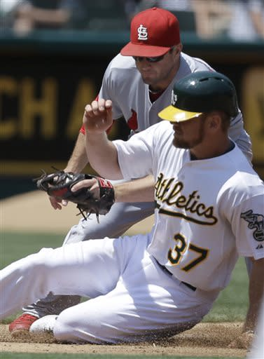 A's rally to nip Cardinals 7-5