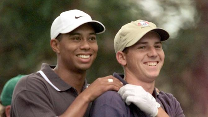 """FILE - In this April 9, 1999 file photo, Tiger Woods, left, grabs the shoulders of Sergio Garcia, from Spain, after Garcia's drive on the second hole during the second round of the Masters golf turnament at the Augusta National Golf Club in Augusta, Ga. Garcia was at a European Tour awards dinner Tuesday night, May 21, 2013 when he was jokingly asked if he would have Woods over for dinner during the U.S. Open. The Spaniard replied, """"We'll have him round every night. We will serve fried chicken."""" Woods took to Twitter on Wednesday, May 22, 2013 and said the comment wasn't silly, rather it was wrong and hurtful. (AP Photo/Elise Amendola, File)"""