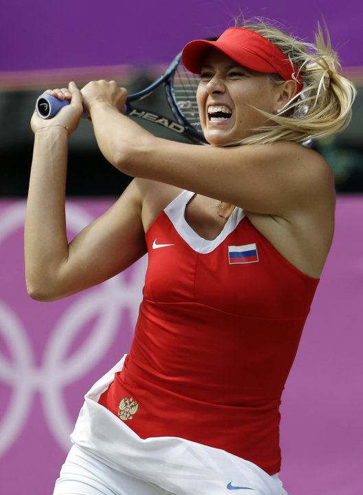 FILE - In this Aug. 4, 2012, file photo, Maria Sharapova, of Russia, returns a shot to Serena Williams, of the United States, in the women's singles gold medal match at the All England Lawn Tennis Clu