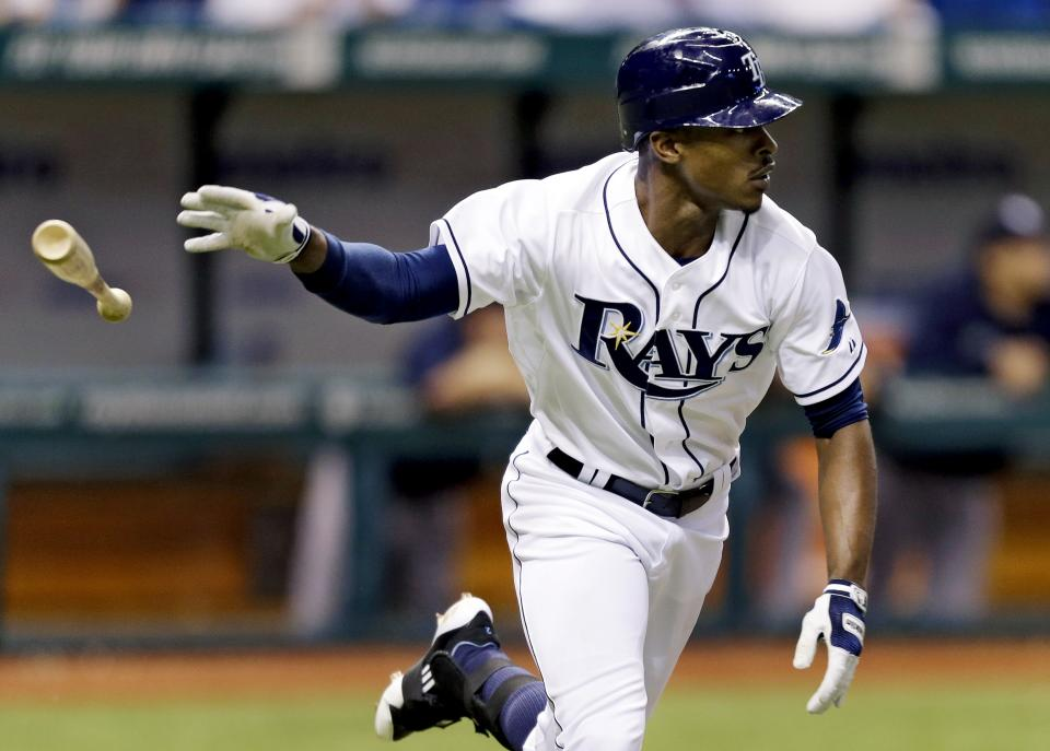Tampa Bay Rays' B.J. Upton flips his bat after hitting a fifth-inning home run off New York Yankees starting pitcher Freddy Garcia during a baseball game, Tuesday, Sept. 4, 2012, in St. Petersburg, Fla. (AP Photo/Chris O'Meara)