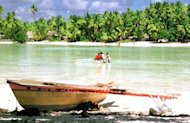 This file illustration photo shows a traditional Micronesian canoe sitting on the shore in Kiribati. A Kiribati fisherman who drifted in the central Pacific for nearly four months has been found alive and asking for cigarettes, a Marshall Islands fishing vessel reported on Friday