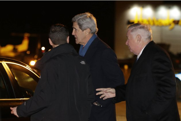 U.S. Secretary of State John Kerry is accompanied by U.S. Ambassador Louis Susman, upon his arrival for his first official trip overseas as Secretary, at the Stansted Airport