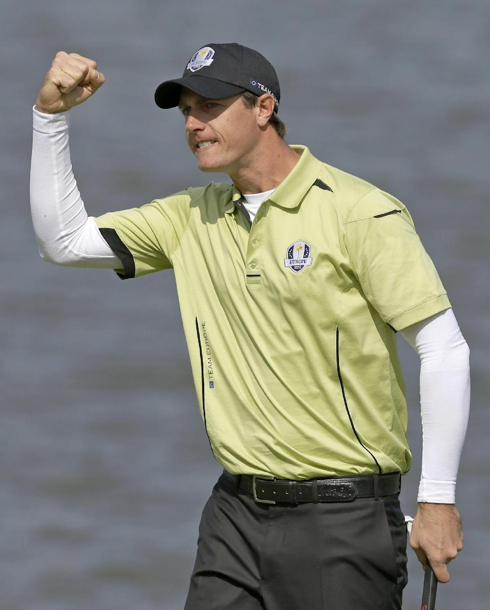 Europe's Nicolas Colsaerts reacts after making a birdie putt on the second hole during a four-ball match at the Ryder Cup PGA golf tournament Friday, Sept. 28, 2012, at the Medinah Country Club in Medinah, Ill. (AP Photo/Chris Carlson)