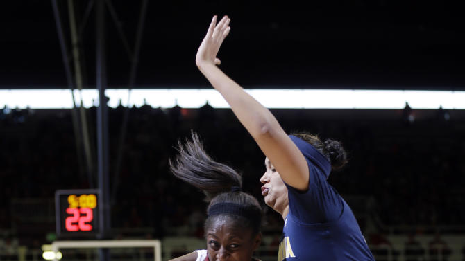 Stanford 's Chiney Ogwumike (13) tries to get past California 's Justine Hartman during the first half of an NCAA college basketball game in Stanford, Calif., Sunday, Jan. 13, 2013. (AP Photo/Marcio Jose Sanchez)