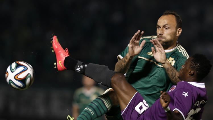 Panathinaikos' Schildenfeld challenges Midtjylland's Hassan during their Europa League play-offs first leg soccer match in Leoforos stadium in Athens