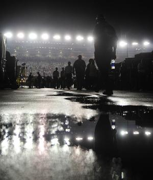 A crew member walks in the garage area before the NASCAR Atlanta Sprint Cup AdvoCare 500 auto race, Sunday, Sept. 4, 2011, at the Atlanta Motor Speedway, in Hampton, Ga. The race that was to start at 7:30 pm has been delayed due to rain. (AP Photo/Rainier Ehrhardt)