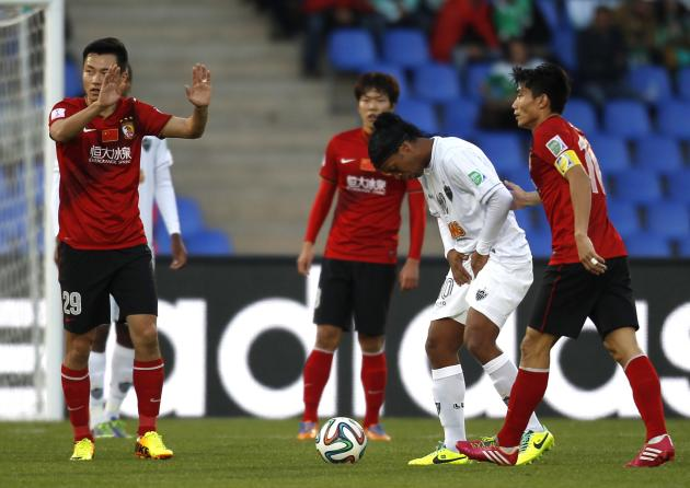 Ronaldinho of Brazil's Atletico Mineiro reacts after fight for the ball with Gao Lin of China's Guangzhou Evergrande during their 2013 FIFA Club World Cup third place soccer match in Marrakech