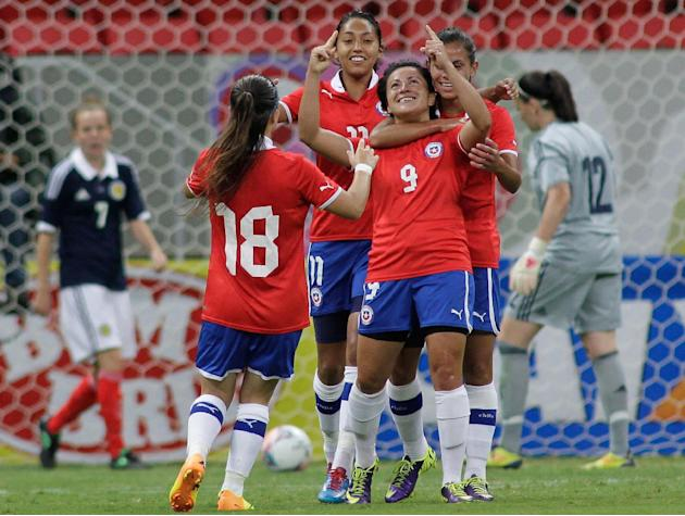 In this Dec. 18, 2013 photo, Chile's Maria Rojas Pino (9) celebrates with teammates after scoring against Scotland during a soccer match at the International Women's Football Tournament in Bra