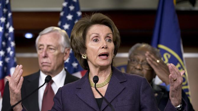 """House Minority Leader Nancy Pelosi, D-Calif., meets with reporters about the fiscal cliff negotiations at the Capitol in Washington, Friday, Dec. 21, 2012. She is joined by House Minority Whip Steny Hoyer, D-Md., left, and Assistant Minority Leader James Clyburn, D-S.C., right. Hopes for avoiding the """"fiscal cliff"""" that threatens the U.S. economy fell Friday after fighting among congressional Republicans cast doubt on whether any deal reached with President Barack Obama could win approval ahead of automatic tax increases and deep spending cuts kick in Jan. 1.  (AP Photo/J. Scott Applewhite)"""