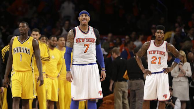New York Knicks forwards Carmelo Anthony (7) and Iman Shumpert (21) react as time runs out on Game 1 of their NBA basketball playoff series in the Eastern Conference semifinals against the Indiana Pacers at Madison Square Garden in New York, Sunday, May 5, 2013. The Pacers won 102-95. (AP Photo/Kathy Willens)
