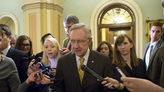 "Senate Majority Leader Harry Reid, D-Nev., retreats to a closed-door meeting with fellow Democrats as he and Senate Minority Leader Mitch McConnell, R-Ky., work to negotiate a legislative path to avoid the so-called ""fiscal cliff,"" at the Capitol in Washington, Sunday, Dec. 30, 2012. Senate and House leaders rushed to assemble a last-ditch agreement to stave off middle-class tax increases and possibly delay steep spending cuts in an urgent attempt to find common ground after weeks of gridlock. (AP Photo/J. Scott Applewhite)"