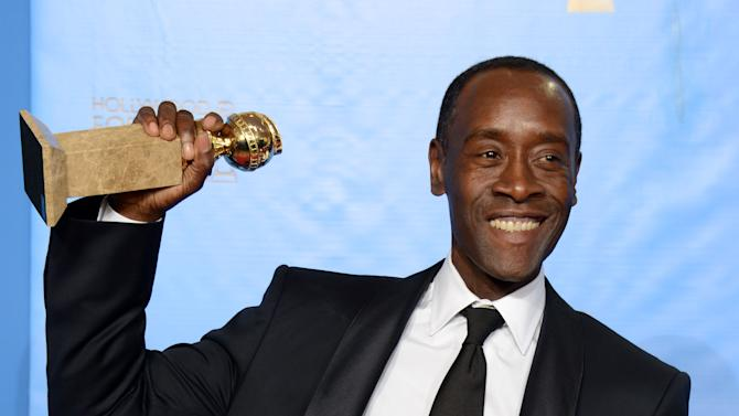 "Actor Don Cheadle poses with the award for best performance by an actor in a television series - comedy or musical for ""House of Lies"" backstage at the 70th Annual Golden Globe Awards at the Beverly Hilton Hotel on Sunday Jan. 13, 2013, in Beverly Hills, Calif. (Photo by Jordan Strauss/Invision/AP)"