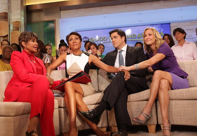 "This image released by ABC shows ""Good Morning America"" co-host Robin Roberts, second left, with her sister Sally-Ann Roberts, left, and co-hosts Josh Elliott and Lara Spencer, right, on the popular morning show on Thursday, Aug. 30, 2012 in New York. Roberts has said goodbye to ""Good Morning America,"" but only for a while. The ""GMA"" anchor made her final appearance Thursday before going on medical leave for a bone marrow transplant. Roberts' departure was first planned for Friday, but she chose to exit a day early to visit her ailing mother in Mississippi. In July she first disclosed that she has MDS, a blood and bone marrow disease. She will be hospitalized next week to prepare for the transplant. The donor will be her older sister, Sally-Ann Roberts. (AP Photo/ABC, Fred Lee)"