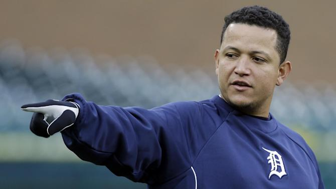 Detroit Tigers third baseman Miguel Cabrera points to an area of the field as he talks to his teammates during the workout at Comerica Park  in Detroit, Friday, Oct. 26, 2012. The Tigers host the San Francisco Giants in Game 3 of baseball's World Series on Saturday. The Giants lead the best-of-seven games series 2-0. (AP Photo/Paul Sancya )