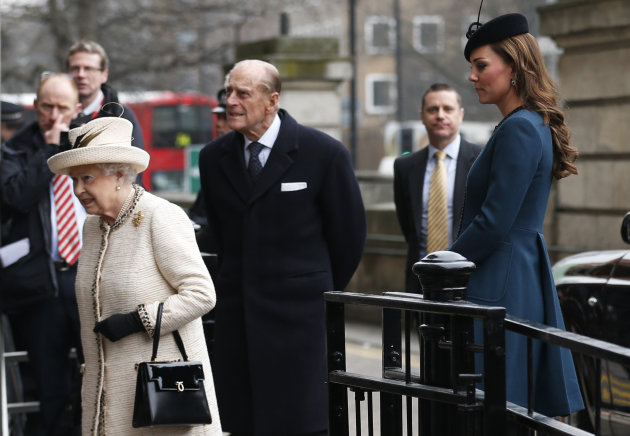 Britain's Kate, Duchess of Cambridge, right, accompanies Queen Elizabeth II, left, and Prince Philip, center, as they arrive at Baker Street underground station in London for a visit to mark the 150th