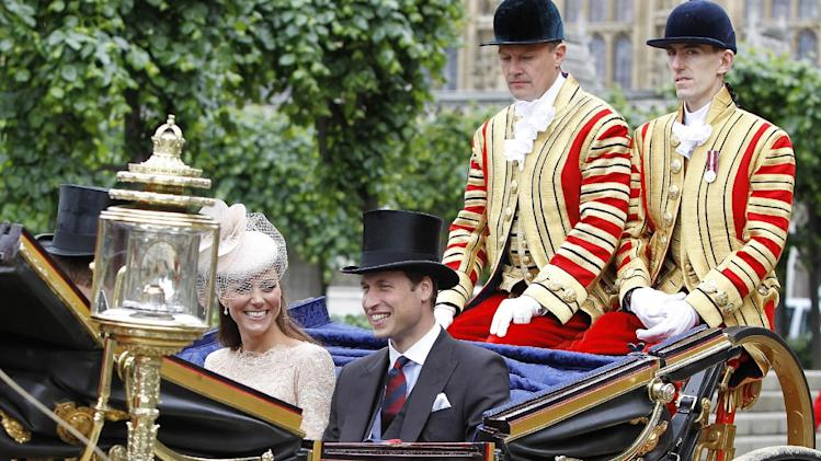 "Britain's Prince William and his wife Kate, Duchess of Cambridge take an open top carriage ride through the streets of London after a Diamond Jubilee Luncheon given for The Queen, Tuesday June 5, 2012 . Crowds cheering ""God save the queen!"" and pealing church bells greeted Queen Elizabeth II on Tuesday as she arrived for a service at St. Paul's Cathedral on the last of four days of celebrations of her 60 years on the throne. (AP Photo/Peter Byrne/Pool)"