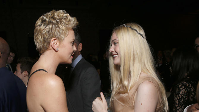 Charlize Theron and Elle Fanning attend the 24th Annual GLAAD Media Awards at the JW Marriott on Saturday, April 20, 2013 in Los Angeles. (Photo by Todd Williamson/Invision/AP)